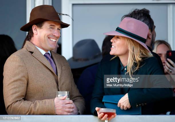 Peter Phillips and Autumn Phillips watch the racing as they attend day 4 'Gold Cup Day' of the Cheltenham Festival 2020 at Cheltenham Racecourse on...