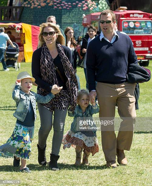 Peter Phillips and Autumn Phillips with Isla Phillips and Savannah Phillips at the Royal Windsor Horse show in the private grounds of Windsor Castle...