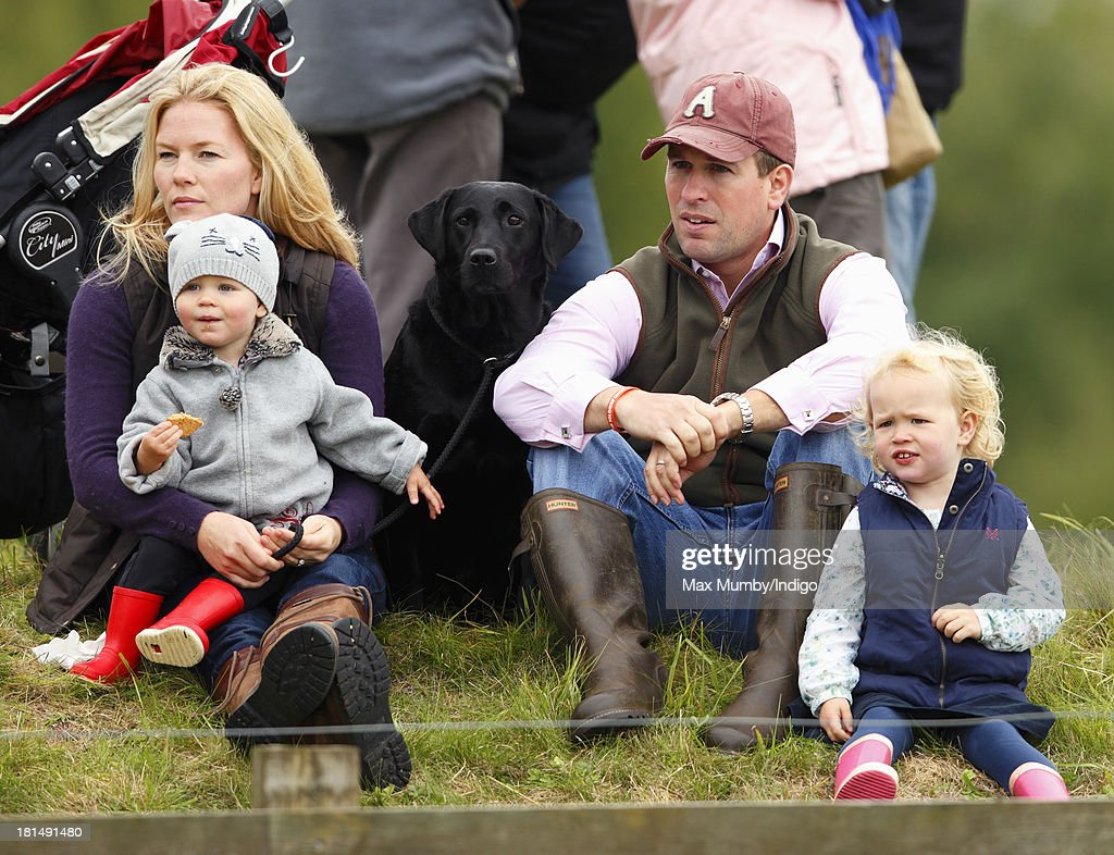 Peter Phillips and Autumn Phillips with their children Savannah Phillips (right) and Isla Phillips (left) watch the cross country phase of the Gatcombe Horse Trials at Gatcombe Park, Minchinhampton on September 21, 2013 in Stroud, England.