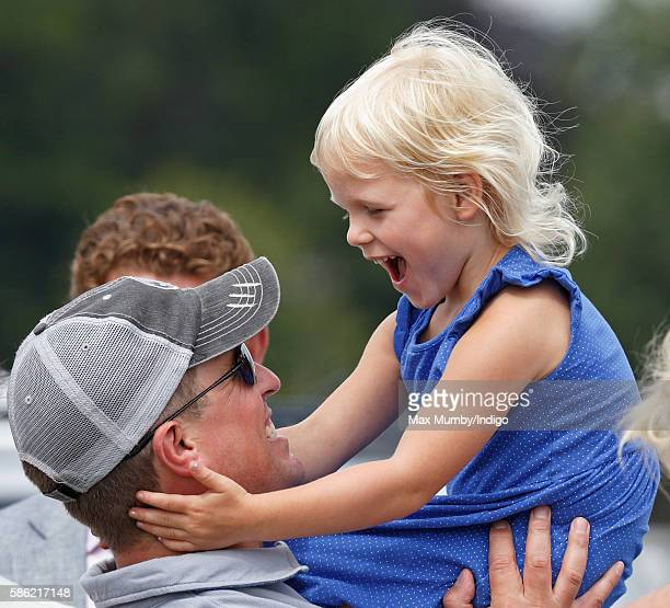 Peter Phillips and daughter Isla Phillips watch Zara Phillips compete in the dressage phase of the Festival of British Eventing at Gatcombe Park on...