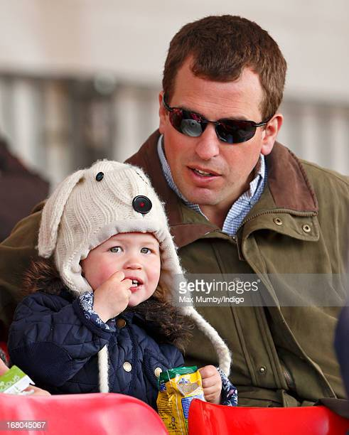 Peter Phillips and daughter Savannah Phillips watch Zara Phillips compete in the dressage phase of the Badminton Horse Trials on May 4 2013 in...