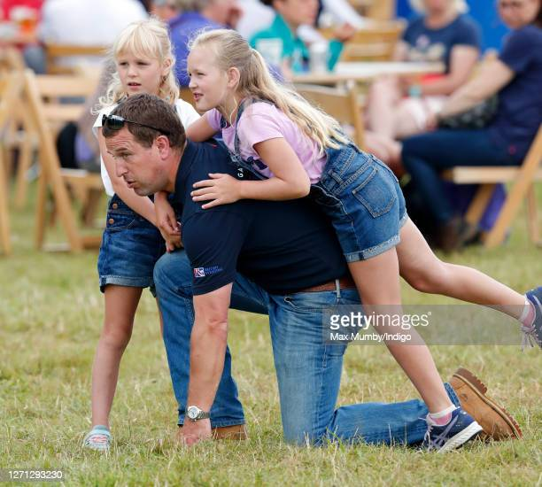 Peter Phillips and daughters Isla Phillips and Savannah Phillips attend day 1 of the 2019 Festival of British Eventing at Gatcombe Park on August 2...