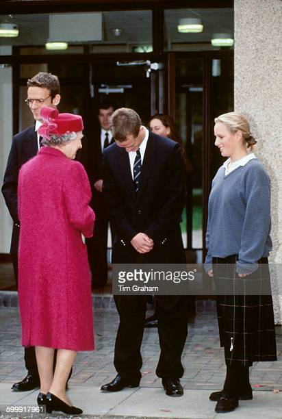 Peter Phillips and his sister Zara greet their grandmother Queen Elizabeth II on her arrival for a visit to Gordonstoun school where they are...