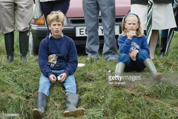 Peter Phillips and his sister Zara Phillips sitting on a grassy bank at Great Somerford Wiltshire England Great Britain 31 July 1988 Zara and Peter...