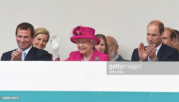 Peter Phillips and Prince William Duke of Cambridge look on as Queen Elizabeth II waves to guests attending 'The Patron's Lunch' celebrations for The...