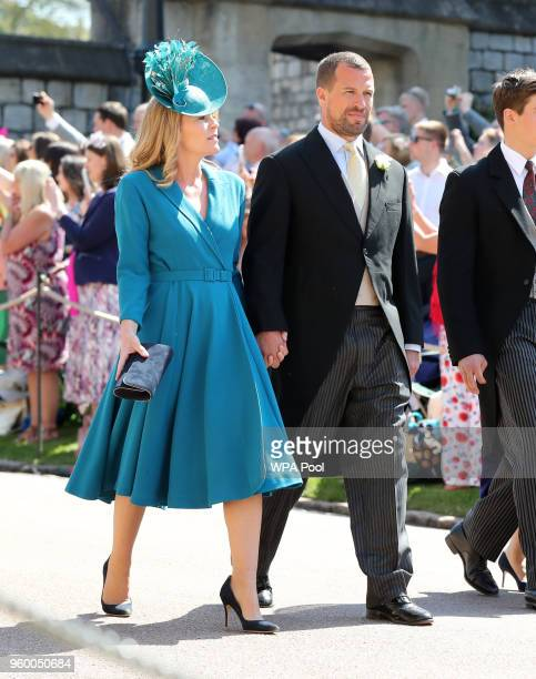 Peter Phillips and wife Autumn Phillips arrive at St George's Chapel at Windsor Castle before the wedding of Prince Harry to Meghan Markle on May 19...