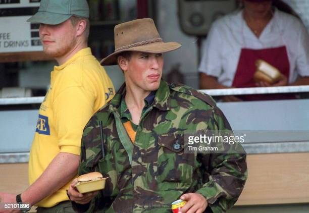 Peter Phillips At Gatcombe Horse Trials At Gatcombe Park He Has Just Bought A Burger And A Can Of Drink From A Trade Stand