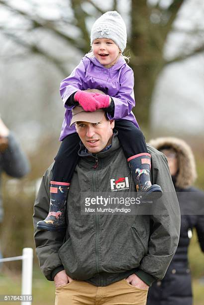 Peter Phillips carries daughter Isla Phillips on his shoulders as they attend the Gatcombe Horse Trails at Gatcombe Park Minchinhampton on March 26...