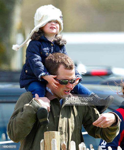 Peter Phillips carries his daughter Savannah Phillips on his shoulders as they attend day 3 of the Badminton Horse Trials on May 4 2013 in Badminton...