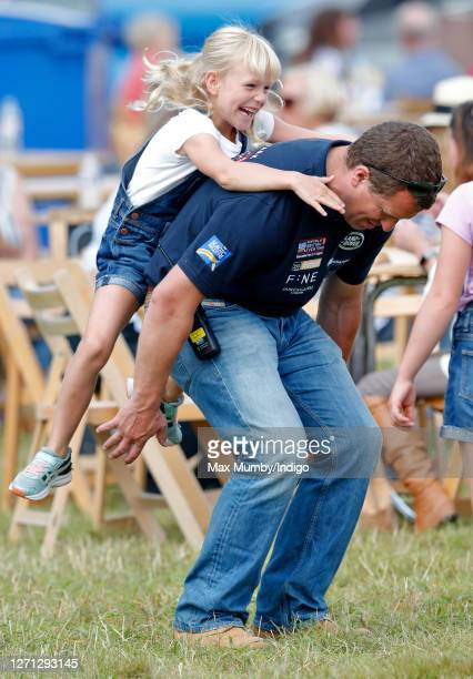 Peter Phillips gives daughter Isla Phillips a piggyback as they attend day 1 of the 2019 Festival of British Eventing at Gatcombe Park on August 2...