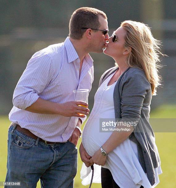 Peter Phillips kisses his heavily pregnant wife Autumn Phillips as they attend the Gatcombe Horse Trials at Gatcombe Park Minchinhampton on March 24...