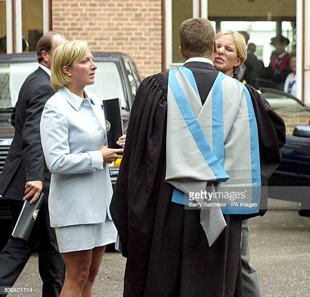 Peter Phillips kisses his sister Zara watched by his friend Elizabeth Iorio at his graduation at a ceremony at Exeter University The Princess Royal...