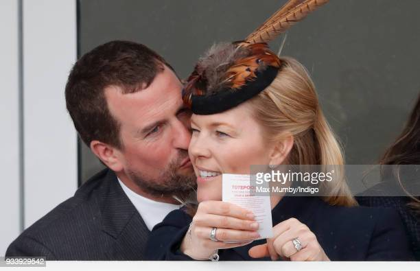 Peter Phillips kisses wife Autumn Phillips as they attend day 4 'Gold Cup Day' of the Cheltenham Festival at Cheltenham Racecourse on March 16, 2018...