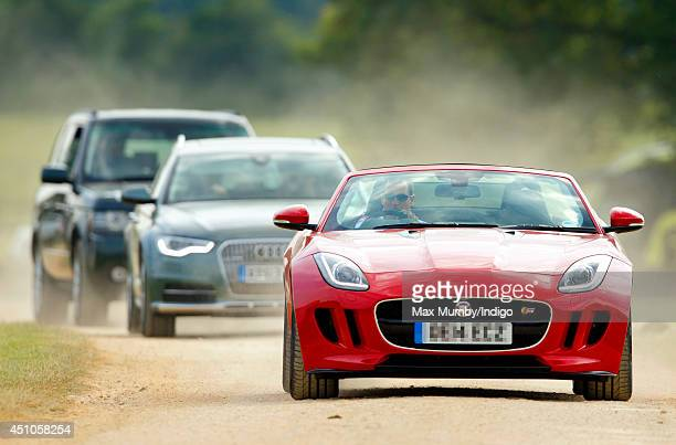 Peter Phillips leaves the Beaufort Polo Club driving a Jaguar FType S Convertible followed by his cousins Prince Harry and Prince William Duke of...