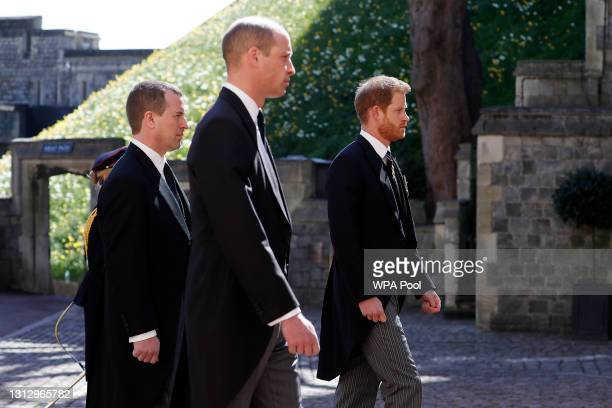 Peter Phillips, Prince William, Duke of Cambridge and Prince Harry, Duke of Sussex during the Ceremonial Procession during the funeral of Prince...