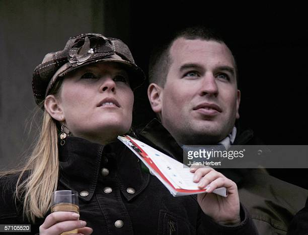 Peter Phillips, son of The Princess Royal, and his girlfriend Autumn Kelly watch the racing on the third day of The Annual National Hunt Festival...
