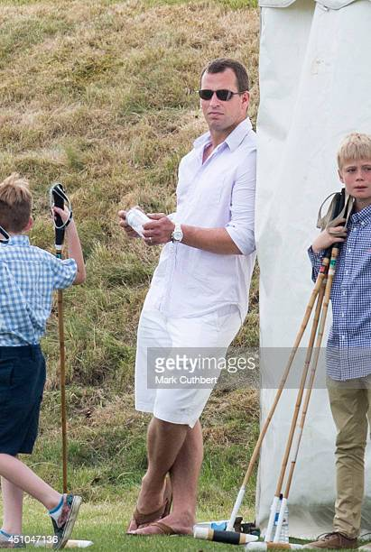 Peter Phillips watches Prince William and Prince Harry in a charity polo match at Beaufort Polo Club on June 22 2014 in Tetbury England