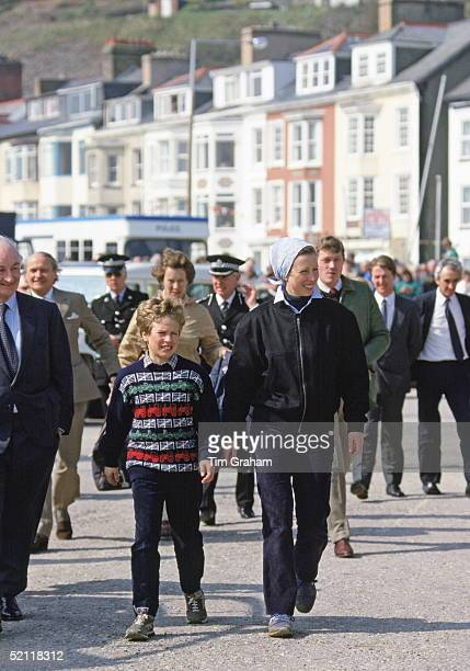 Peter Phillips With His Mother, Princess Anne, Visiting An Outward Bound Centre In Aberdovey, Wales.the Princess's Bodyguard Behind The Princess At...