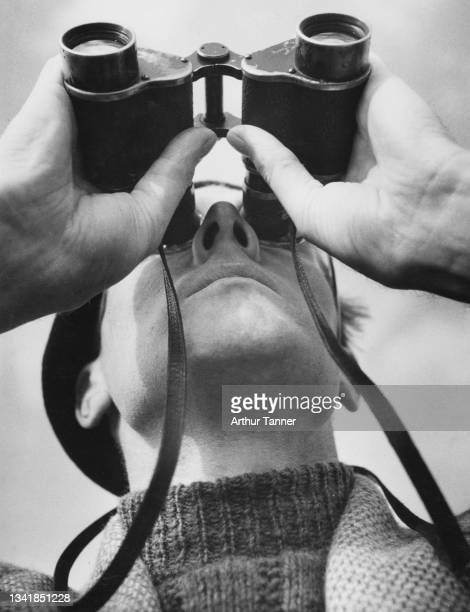 Peter Pointon Taylor of the Royal Observer Corps scans the sky with binoculars searching for German Luftwaffe aircraft from an observer post along...