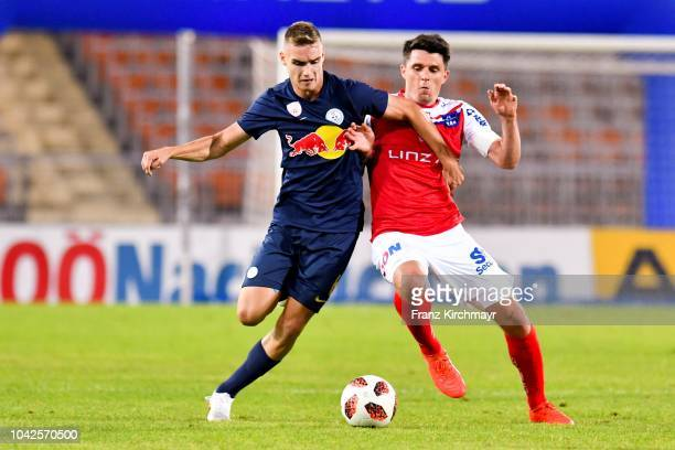Peter Pokorny of Liefering and Manuel Hartl of FC Linz compete for the ball during the 2 Liga match between FC Blau Weiss Linz v FC Liefering at TGW...