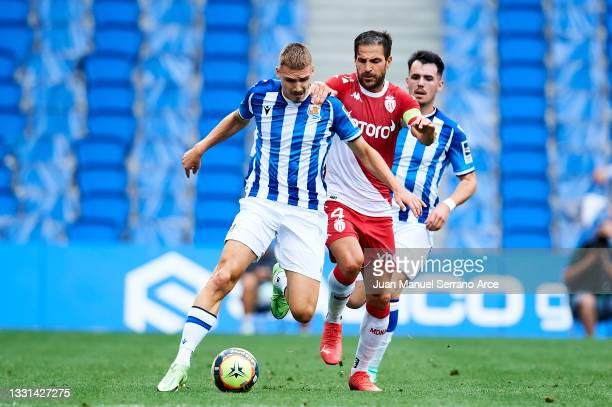 Peter Pokorny of Real Sociedad duels for the ball with Cesc Fabregas of AS Monaco during the Friendly Match between Real Sociedad and As Monaco at...