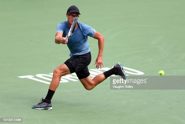 Peter Polansky of Canada plays a shot against Novak Djokovic of Serbia during a 2nd round match on Day 3 of the Rogers Cup at Aviva Centre on August...