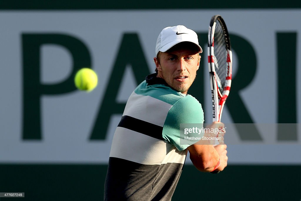 Peter Polansky of Canada returns a shot to Juan Monoco of Argentina during the BNP Parabas Open at the Indian Wells Tennis Garden on March 6, 2014 in Indian Wells, California.