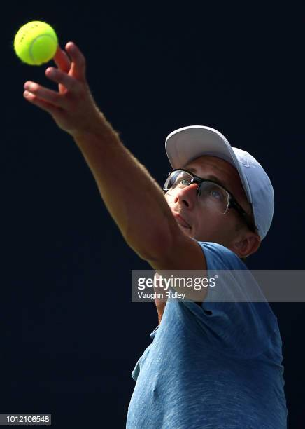 Peter Polansky of Canada serves against Matthew Ebden of Australia during a 1st round match on Day 1 of the Rogers Cup at Aviva Centre on August 6...