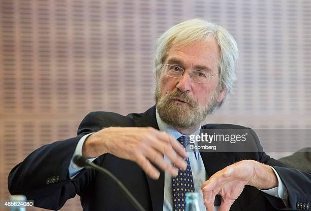 Peter Praet chief economist at the European Central Bank gestures as he addresses the European Central Bank and its watchers conference in Frankfurt...