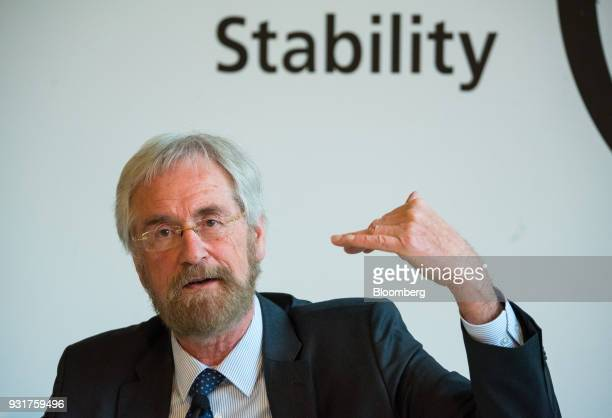 Peter Praet chief economist at the European Central Bank gestures while speaking at the 'ECB and its Watchers' conference in Frankfurt Germany on...