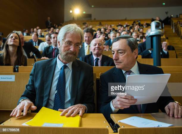 Peter Praet chief economist at the European Central Bank left sits beside Mario Draghi president of the European Central Bank in the audience ahead...