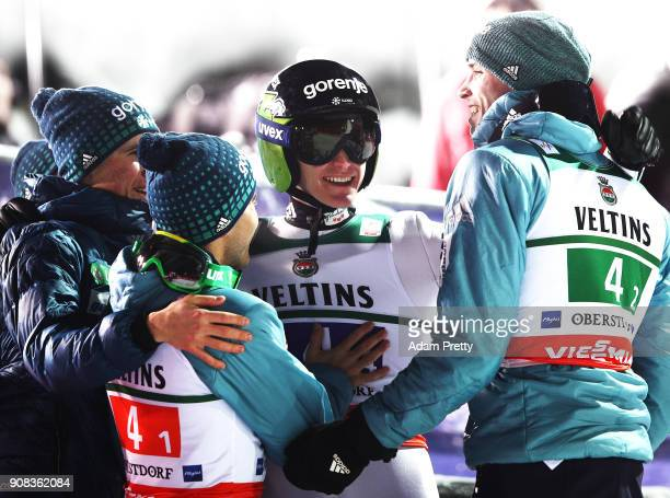 Peter Prevc Domen Prevc Jernej Damjan and Anze Semenic of Slovenia celebrate winning the silver medal of the Flying Hill Team competition of the Ski...