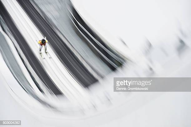 Peter Prevc of Slovenia accelerates down the inrun during his training jump on Day 1 of the 64th Four Hills Tournament ski jumping event on December...