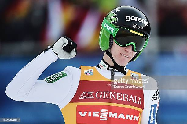 Peter Prevc of Slovenia celebrates after his competition jump on Day 2 of the 64th Four Hills Tournament ski jumping event on January 1 2016 in...