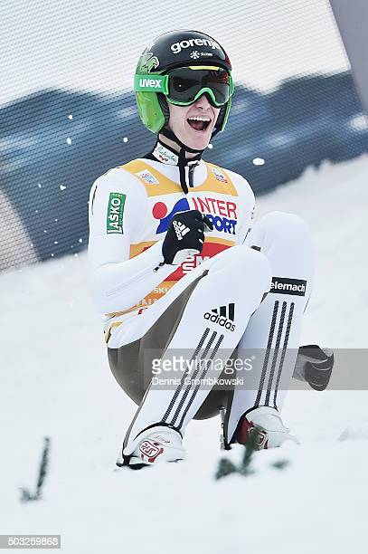 Peter Prevc of Slovenia celebrates as he wins the Innsbruck 64th Four Hills Tournament ski jumping event on January 3 2016 in Innsbruck Austria