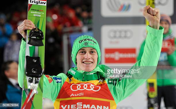 Peter Prevc of Slovenia celebrates in finish area his victory of the Four Hills competition of the FIS Ski Jumping World Cup in Bischofshofen on...