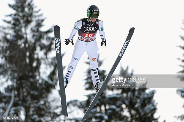 Peter Prevc of Slovenia competes at the trail round on Day 2 of the 65th Four Hills Tournament ski jumping event at PaulAusserleitnerSchanze on...