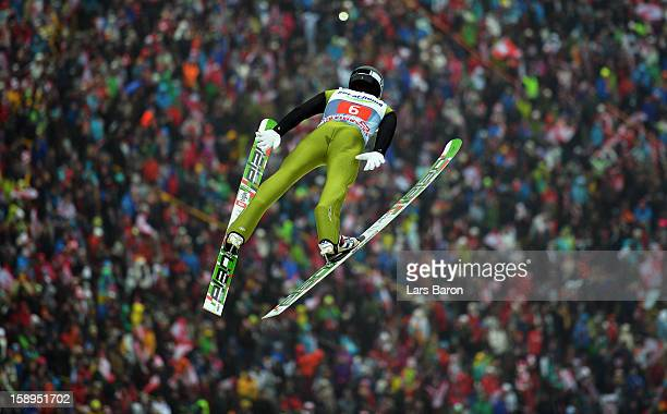 Peter Prevc of Slovenia competes during the first round for the FIS Ski Jumping World Cup event of the 61st Four Hills ski jumping tournament at...