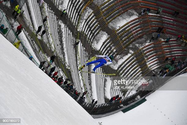 TOPSHOT Peter Prevc of Slovenia jumps during the training round for the third stage of the 66th Four Hills Tournament in Innsbruck Austria on January...