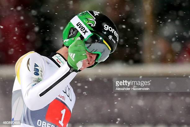 Peter Prevc of Slovenia reacts after his first round jump on day 2 of the Four Hills Tournament Ski Jumping event at SchattenbergSchanze Erdinger...