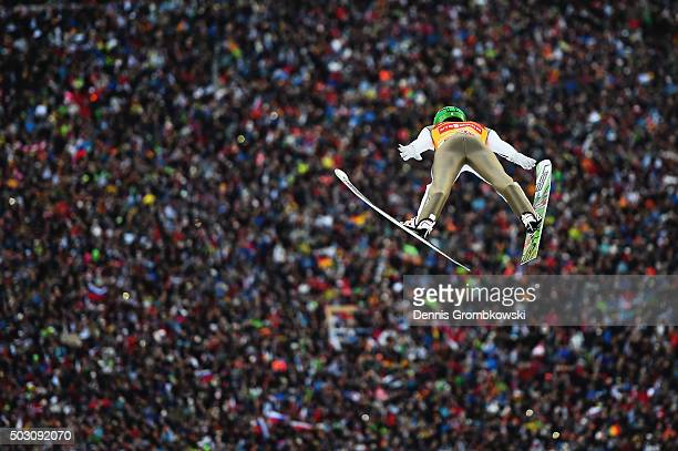 Peter Prevc of Slovenia soars through the air during his competition jump on Day 2 of the 64th Four Hills Tournament ski jumping event on January 1...