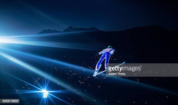 Peter Prevc of Slovenia soars through the air during his first competition jump on Day 2 of the 65th Four Hills Tournament ski jumping event on...