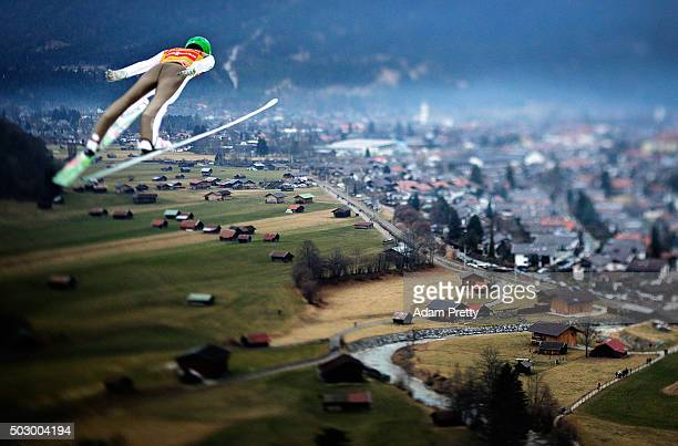 Peter Prevc of Slovenia soars through the air during his practice jump on Day 1 of the 64th Four Hills tounament on December 31 2015 in...