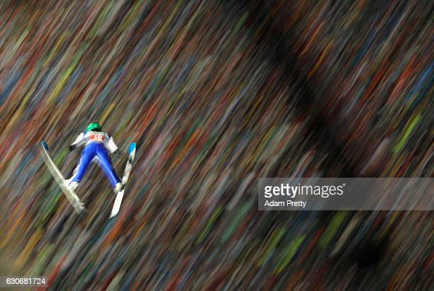 Peter Prevc of Slovenia soars through the air during his second competition jump on Day 2 of the 65th Four Hills Tournament ski jumping event on...