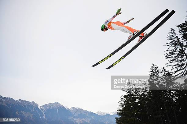 Peter Prevc of Slovenia soars through the air during his training jump on day 1 of the 64th Four Hills Tournament ski jumping event on January 2 2016...