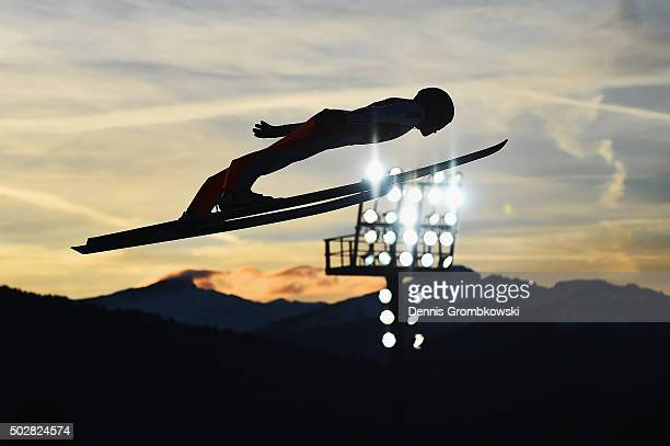 Peter Prevc of Slovenia soars through the air during his trial jump on Day 2 of the 64th Four Hills Tournament event on December 29 2015 in...