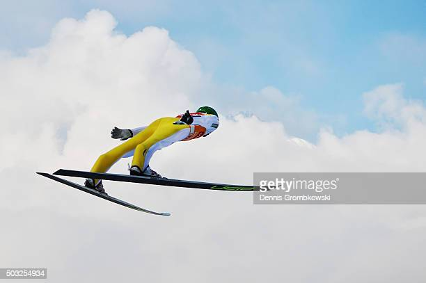 Peter Prevc of Slovenia soars through the air during his trial jump on Day 2 of the Innsbruck 64th Four Hills Tournament ski jumping event on January...