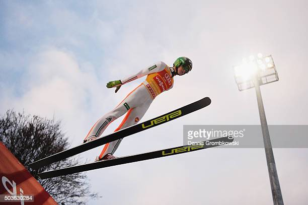 Peter Prevc of Slovenia soars through the air during his trial jump on Day 2 of the Bischofshofen 64th Four Hills Tournament ski jumping event on...