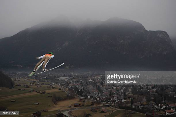Peter Prevc of Slovenia soars throught the air during his qualification jump on Day 1 of the 64th Four Hills Tournament ski jumping event on December...