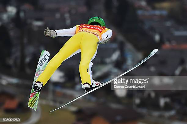 Peter Prevc of Slovenia soars throught the air during his training jump on Day 1 of the 64th Four Hills Tournament ski jumping event on December 31...